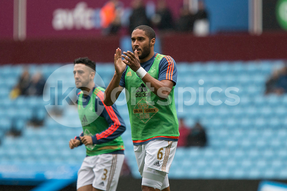 Swansea captain Ashley Williams greets the travelling fans ahead of the Barclays Premier League match between Aston Villa and Swansea City at Villa Park, Birmingham, England on 24 October 2015. Photo by Mark Hawkins.