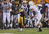October 2 2010: Iowa Hawkeyes wide receiver Paul Chaney Jr. (26) tries to get around Penn State Nittany Lions safety Nick Sukay (1) during the first half of the NCAA football game between the Penn State Nittany Lions and the Iowa Hawkeyes at Kinnick Stadium in Iowa City, Iowa on Saturday October 2, 2010. Iowa defeated Penn State 24-3.