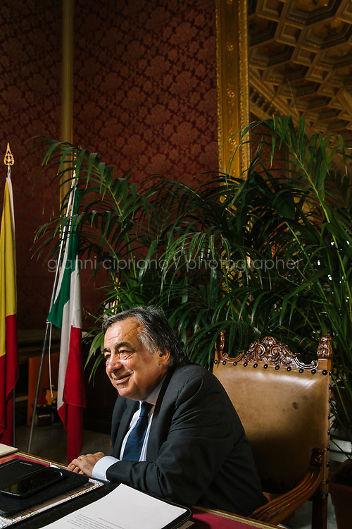 PALERMO, ITALY - 15 JUNE 2018: Mayor of Palermo Leoluca Orlando is seen here during an interview in his office at Palazzo delle Aquile in Palermo, Italy, on June 15th 2018.<br /> <br /> Manifesta is the European Nomadic Biennial, held in a different host city every two years. It is a major international art event, attracting visitors from all over the world. Manifesta was founded in Amsterdam in the early 1990s as a European biennial of contemporary art striving to enhance artistic and cultural exchanges after the end of Cold War. In the next decade, Manifesta will focus on evolving from an art exhibition into an interdisciplinary platform for social change, introducing holistic urban research and legacy-oriented programming as the core of its model.<br /> Manifesta is still run by its original founder, Dutch historian Hedwig Fijen, and managed by a permanent team of international specialists.<br /> <br /> The City of Palermo was important for Manifesta&rsquo;s selection board for its representation of two important themes that identify contemporary Europe: migration and climate change and how these issues impact our cities.