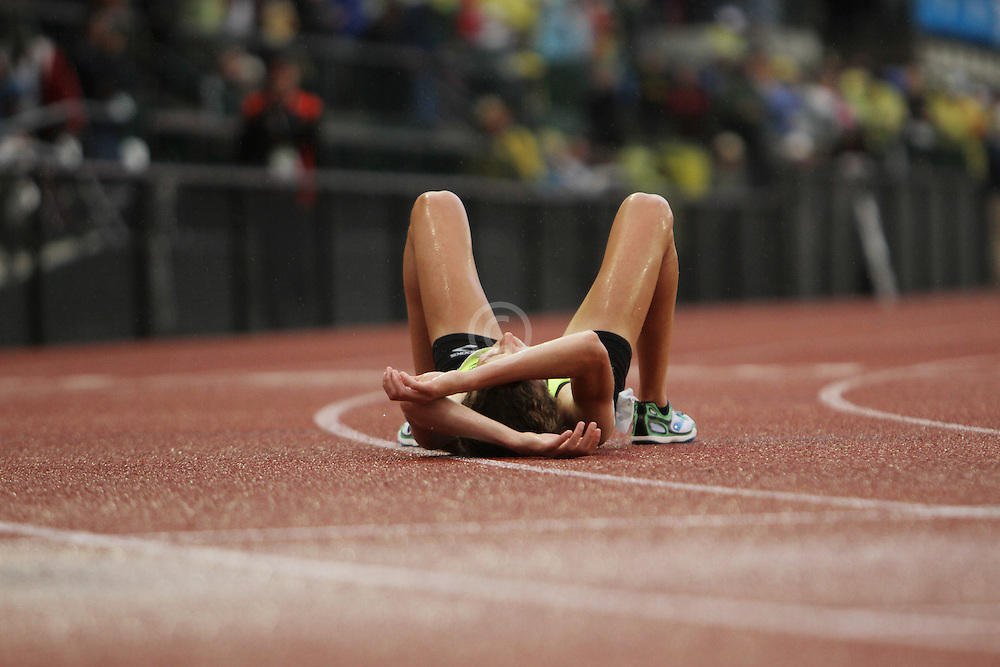 Olympic Trials Eugene 2012: women's 10,000 meter final, Amy Hastings lays on track after winning, making USA Olympic team