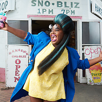 Tank from Tank and tha Bangas holds a snowball in front of Hansen's Sno-Bliz on Tchoupitoulas St.