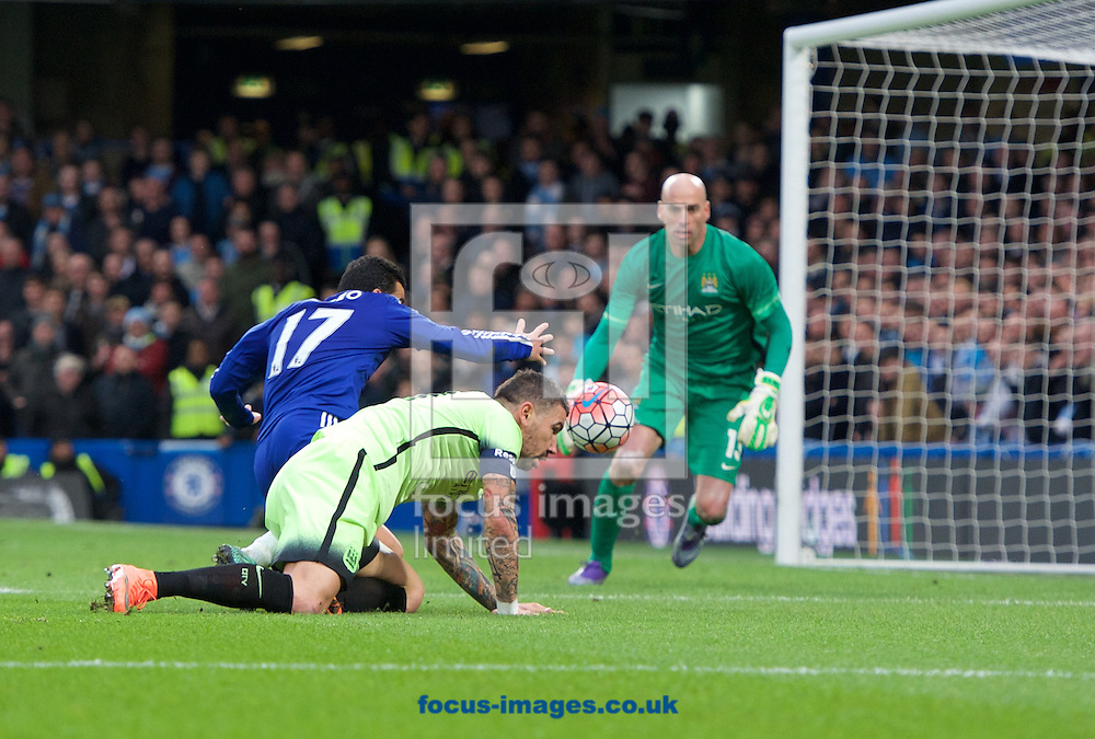 Aleksandar Kolarov of Manchester City tries to head the ball back to goalkeeper Wilfredo Caballero while pressured by Pedro of Chelsea during the FA Cup match at Stamford Bridge, London<br /> Picture by Alan Stanford/Focus Images Ltd +44 7915 056117<br /> 21/02/2016