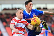 Ian Henderson, Craig Alcock during the Sky Bet League 1 match between Doncaster Rovers and Rochdale at the Keepmoat Stadium, Doncaster, England on 21 November 2015. Photo by Daniel Youngs.