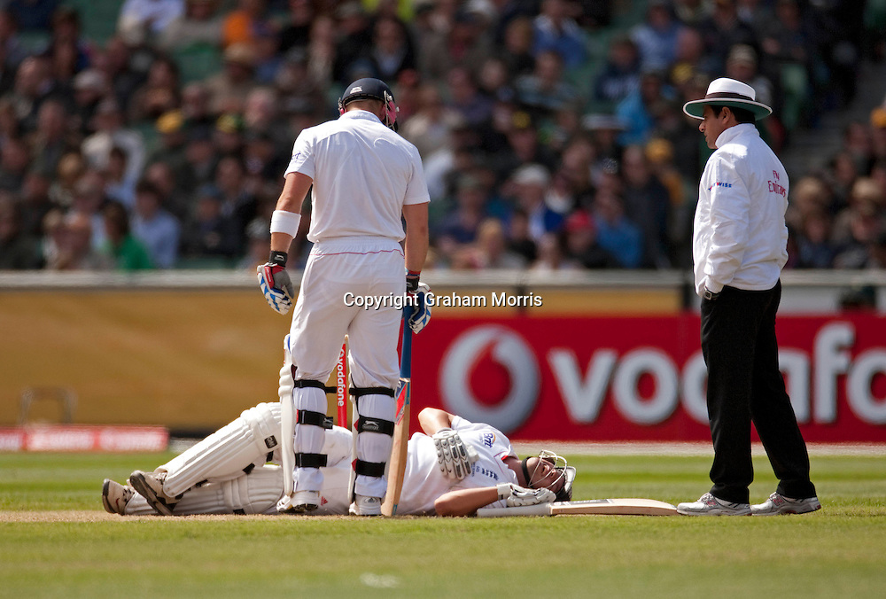 Jonathan Trott down, injured, during the fourth Ashes test match between Australia and England at the MCG in Melbourne, Australia. Photo: Graham Morris (Tel: +44(0)20 8969 4192 Email: sales@cricketpix.com) 27/12/10
