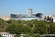 Maison de la Radio, headquarters of Radio France, designed by Henry Bernard and completed in 1963, in the 16th arrondissement of Paris, France, seen from the Peas & Love urban farm on the roof of Hotel Yooma at Beaugrenelle across the river Seine in the 15th arrondissement. The circular building was renovated 2005-14. Picture by Manuel Cohen