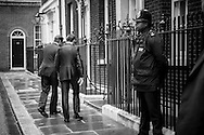 The British Prime Minister David Cameron (le) leads Anders Fogh Rasmussen, Secretary General for NATO,  into Downing Street number 10, London, for a bilateral meeting as preparation for the upcoming NATO Summit in Chicago.