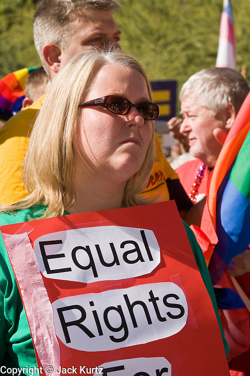 15 NOVEMBER 2008 -- PHOENIX, AZ: A woman with an equal rights sign at a gay rights rally in Pheonix. About 1,500 people, gay and straight, participated in a rally at the Phoenix, AZ, city hall to protest the passage of Proposition 102 in Arizona and Proposition 8 in California on November 4. In both states the propositions essentially defined marriage as between a man and woman and banned same sex marriages. The protest in Phoenix was one of several held across the United States Saturday. Photo by Jack Kurtz / ZUMA Press