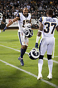 Los Angeles Rams wide receiver Robert Woods (17) celebrates with Los Angeles Rams defensive back Sam Shields (37) after a fourth quarter interception during the 2018 regular season week 1 NFL football game against the Oakland Raiders on Monday, Sept. 10, 2018 in Oakland, Calif. The Rams won the game 33-13. (©Paul Anthony Spinelli)