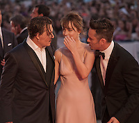 Actor Johnny Depp, actress Dakota Johnson, director Scott Cooper at the gala screening for the film Black Mass at the 72nd Venice Film Festival, Friday September 4th 2015, Venice Lido, Italy.