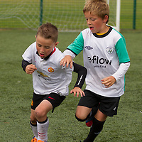 Cathal Morgan and Eoin Byrne go for the ball during the soccer match at the FAI Eflow Summer Soccer School in Lisdoonvarna