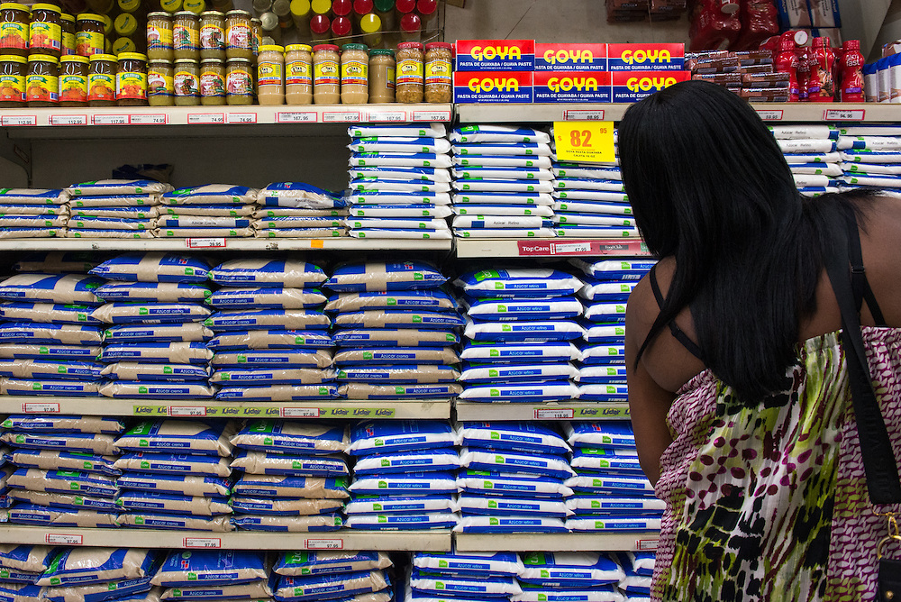 """Bags of white and brown sugar are stocked on the shelves of Dominican box store """"Jumbo"""" in San Pedro de Macoris, Jan. 8, 2014. The megastore is financially associated with the Vicinis, an influential Dominican family that owns one of the two largest private sugar production operations in the country, and has been repeatedly criticized for poor treatment of cane workers."""