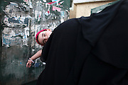 An Egyptian women with a sleeping child as many line up  to get into a a polling station in   Cairo , Egypt May 23, 2012. Egyptians head to the polling stations throughout Egypt  Wednesday for an historic opportunity in which they will for the first time to pick their president in a wide open election that pits Islamists against men who served under deposed leader Hosni Mubarak.(Photo by Heidi Levine/Sipa Press).