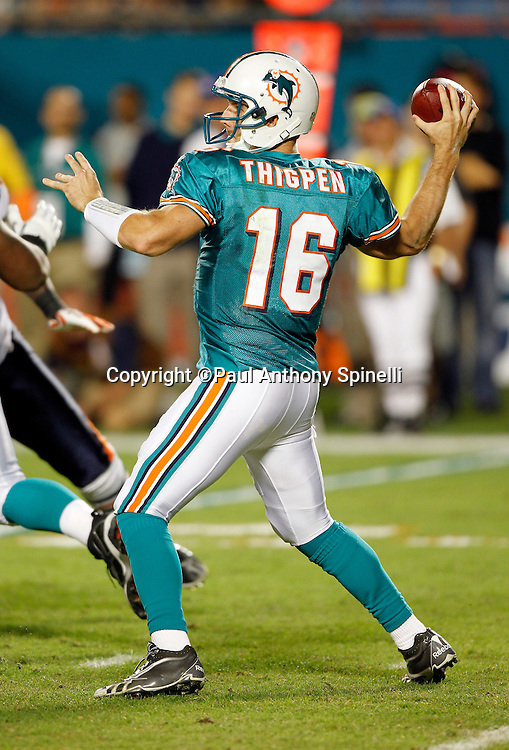 Miami Dolphins quarterback Tyler Thigpen (16) throws a third quarter pass during the NFL week 11 football game against the Chicago Bears on Thursday, November 18, 2010 in Miami Gardens, Florida. The Bears won the game 16-0. (©Paul Anthony Spinelli)