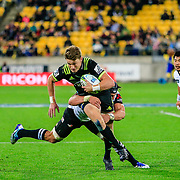 Beauden Barrett running during the Super Rugby union game between Hurricanes and Sunwolves, played at Westpac Stadium, Wellington, New Zealand on 27 April 2018.   Hurricanes won 43-15.