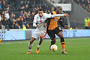 Milton Keynes Dons midfielder, on loan from Norwich City, Josh Murphy(31) and Hull City midfielder Sone Aluko (24)during the Sky Bet Championship match between Hull City and Milton Keynes Dons at the KC Stadium, Kingston upon Hull, England on 12 March 2016. Photo by Ian Lyall.