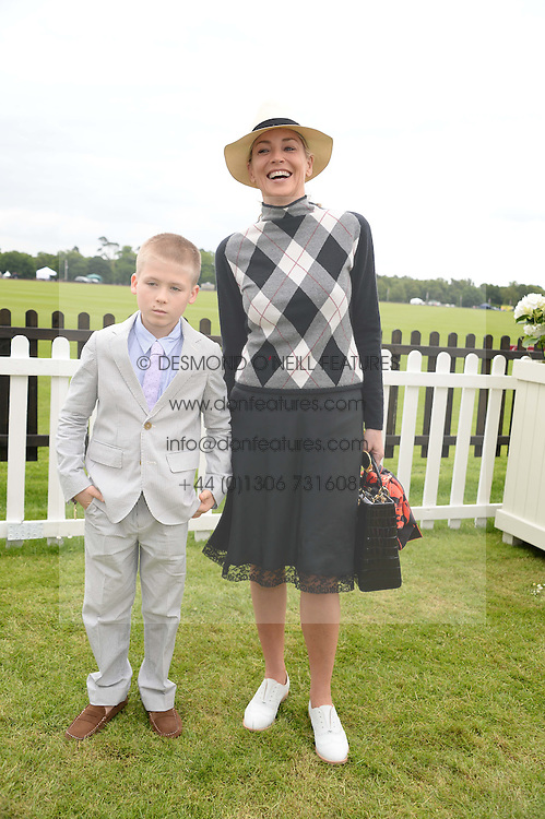 SHARON STONE and her son ROAN JOSEPH BRONSTEIN at the 2013 Cartier Queens Cup Polo at Guards Polo Club, Berkshire on 16th June 2013.
