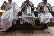 Prison women doing embroidery inside Thika Women's Prison. At present there are 6 young children inside the prison that get looked after in a small cell for the day whilst the mothers go to work. Action for children in conflict (AFCIC) provides clothes and resources for the children to play with.