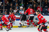 KELOWNA, CANADA - MARCH 2: John Ludvig #15 of the Portland Winterhawks checks Leif Mattson #28 of the Kelowna Rockets into the boards during first period on March 2, 2019 at Prospera Place in Kelowna, British Columbia, Canada.  (Photo by Marissa Baecker/Shoot the Breeze)