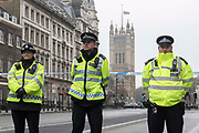 UNITED KINGDOM, London: 23 March 2017 Police stand guard in front of a cordon blocking access to Parliament Square this morning after a terror attack which killed four people including the attacker in Westminster yesterday. Rick Findler / Story Picture Agency