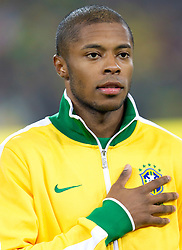 Michel Bastos of Brazil singing national anthem during the 2010 FIFA World Cup South Africa Group G Second Round match between Brazil and République de Côte d'Ivoire on June 20, 2010 at Soccer City Stadium in Soweto, suburban Johannesburg, South Africa.  Brazil defeated Ivory Coast 3-1. (Photo by Vid Ponikvar / Sportida)