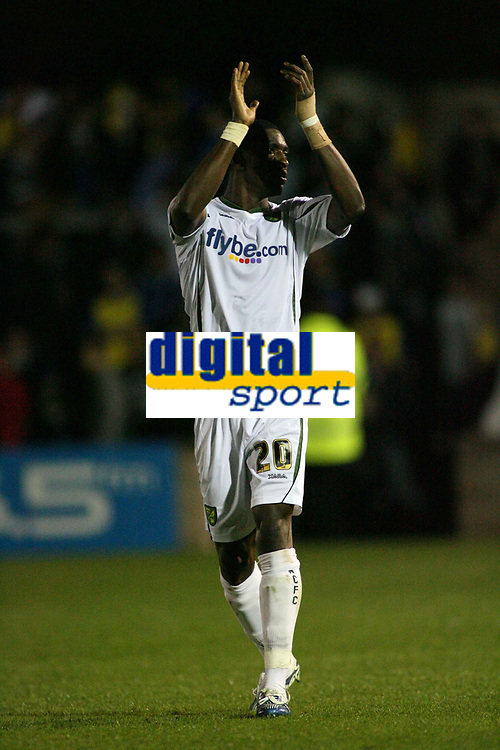Photo: Rich Eaton.<br /> <br /> Torquay United v Norwich City. Carling Cup. 23/08/2006. Dickson Etuhu, scorer of Norwichs second goal applauds Norwichs travelling fans at the end of the game