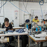 Workers inside the TexOps factory, around 40 minutes by car from San Salvador. Famous and modern factory in El Salvador, TexOps produces sport and yoga clothes for famous brands around the world, in particular in Italy and USA. There are around 1250 people working here in this factory