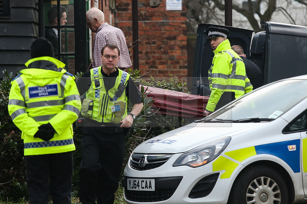 © Licensed to London News Pictures. 13/02/2017. Leeds, UK. A body is removed from the Old Red Lion pub in the Seacroft area of Leeds where a man is reported to have died. The cause of the man's death is as yet unknown. He was found with serious injuries at 11am this morning. Photo credit : Ian Hinchliffe/LNP