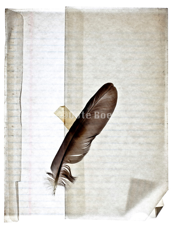 lined notepad paper in translucent envelope with quill
