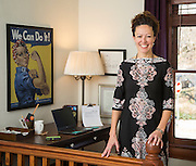 Dr. Janine Perry stands in her home office on Tuesday, December 8, 2015, in Fayetteville, Arkansas. Photo by Beth Hall