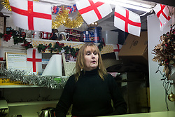 London, UK. 20 December, 2019. Cheryl Diamond talks to Dave Conway, the very last customer of Syd's Coffee Stall, which has been run by three generations of the same family on the corner of Shoreditch High Street and Calvert Avenue since 1919. The mahogany coffee stall, part of east London's history, will go on display in the new Museum of London in Smithfield in 2024.