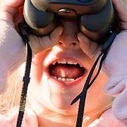 Jade Goodrich looks through her first pair of binoculars.