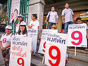 17 FEBRUARY 2013 - BANGKOK, THAILAND:  Supporters of Pongsapat Pongchareon wait for Pongsapat during a campaign rally. Nine is Pongsapat's number on the ballot. Pol General Pongsapat Pongcharoen, a former deputy national police chief who also served as secretary-general of the Narcotics Control Board is the Pheu Thai Party candidate in the upcoming Bangkok governor's election. (He resigned from the police force to run for Governor.) Former Prime Minister Thaksin Shinawatra reportedly recruited Pongsapat. Most of Thailand's reputable polls have reported that Pongsapat is leading in the race and likely to defeat Sukhumbhand Paribatra, the Thai Democrats' candidate and incumbent. The loss of Bangkok would be a serious blow to the Democrats, whose base is the Bangkok area.     PHOTO BY JACK KURTZ
