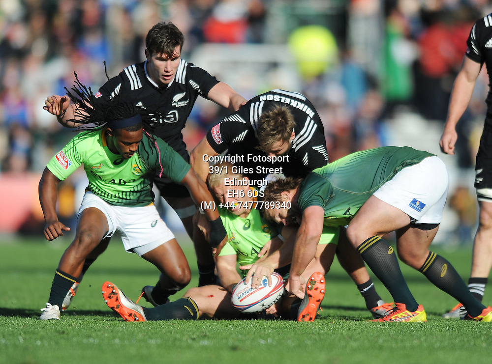 Kyle Brown - South Africa is wrapped up by Tim Kikkelson - New Zealand.<br />