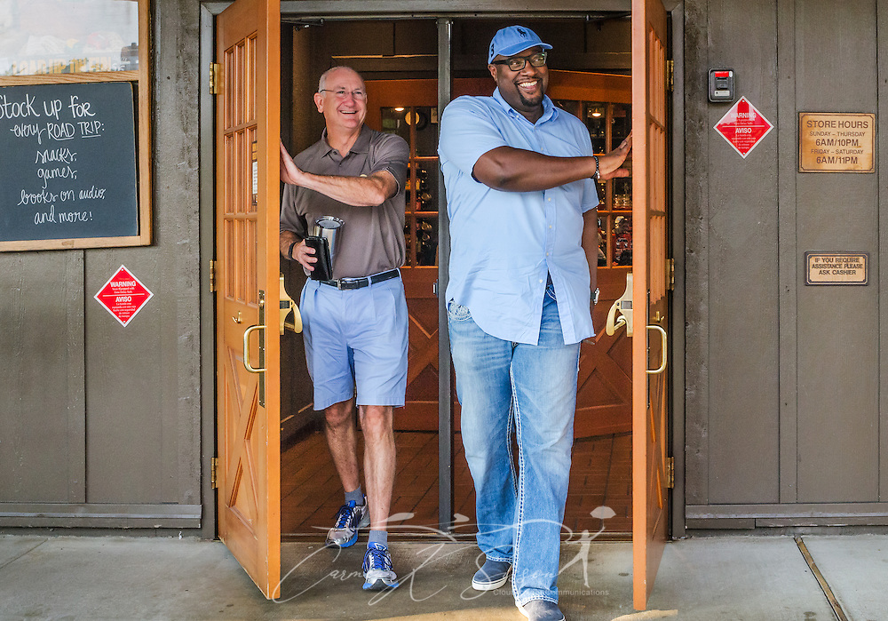 Oak Mountain Presbyterian Church Pastor Bob Flayhart and Urban Hope Community Church Pastor Alton Hardy  smile as they exit Cracker Barrel restaurant after having breakfast together, July 17, 2015, in Birmingham, Ala. Hardy and Flayhart began having weekly breakfasts together more than two years ago — a move they say has been instrumental in forming the trusting relationship needed as their congregations work together to heal race relations in Birmingham. (Photo by Carmen K. Sisson/Cloudybright)