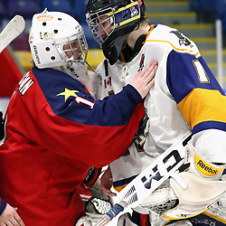 WHITBY, ON - MAR 14,  2017: Ontario Junior Hockey League ,playoff game between  the Whitby Fury and the Wellington Dukes , Connor Ryckman #1 of the Wellington Dukes and Austin Cain #1 of the Whitby Fury<br /> (Photo by Ed McPherson / OJHL Images)
