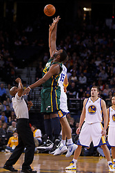 Feb 2, 2012; Oakland, CA, USA; Utah Jazz center Al Jefferson (25) wins the opening tip off from Golden State Warriors center Andris Biedrins (15) during the first quarter at Oracle Arena. Mandatory Credit: Jason O. Watson-US PRESSWIRE