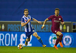 WIGAN, ENGLAND - Monday, February 19, 2018: Wigan Athletic's Will Grigg runs past Manchester City's Kyle Walker to score the winning goal and seal a 1-0 victory during the FA Cup 5th Round match between Wigan Athletic FC and Manchester City FC at the DW Stadium. (Pic by David Rawcliffe/Propaganda)