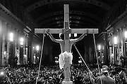 Parishioners at St. Jerome Catholic Parish in Chicago's Rogers Park neighborhood attend a Via Crucis procession, portraying the biblical account of Jesus Christ being condemned to death, followed by his crucifixion and entombment. Portraying Christ is 27 year old Juan Ponce.