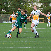 Fraser Valley Cascades' forward Desiree Caruso beats 2nd year midfielder Jet Davies (17) of the Regina Cougars to the ball during the Women's Soccer Homeopener on September 10 at U of R Field. Credit: Arthur Ward/Arthur Images
