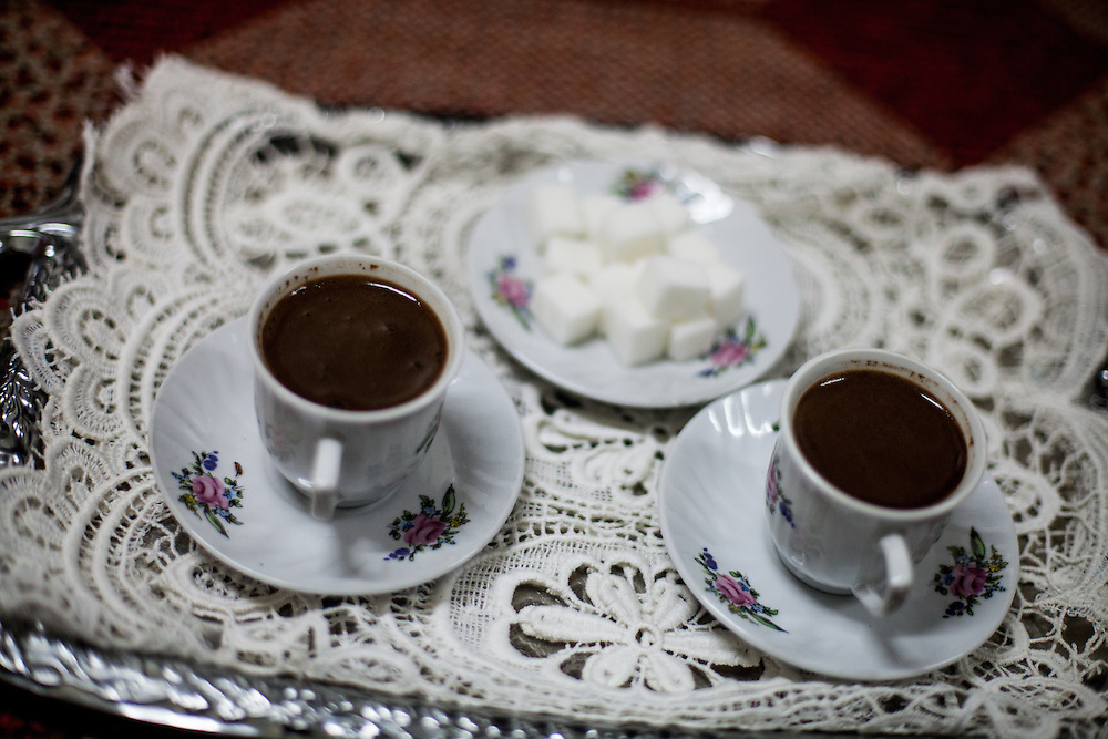 "Turkish coffee served in the house of Mehmet Kershi. Mr. Kershi fled the war  in Kosovo and lives from 1999 in the Konik Camp located in Podgorica. After the fire in 2012 when many inhabitants lost their former housing they received a container in which they live in since then. He has no valid papers such as Passport and Identity Card and is since his arrival in Montenegro unemployed. He partly corporates with the ""Crisis Council of the Association of Displaced Roma and Egyptians from Kosovo in Montenegro"" and belongs to the Egyptians in the community."