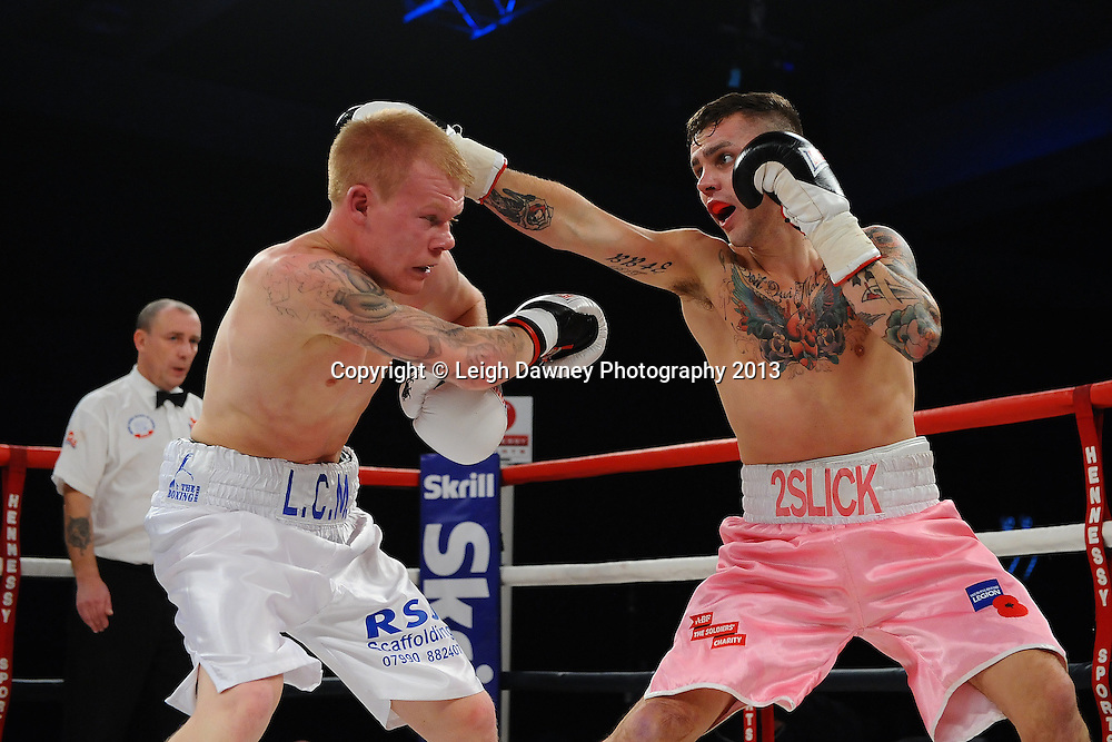 Lee Martin (white shorts) defeats Lewis Jones in a Lightweight contest. Glow, Bluewater, Kent, UK. Hennessy Sports. 16.11.13. © Leigh Dawney Photography 2013.