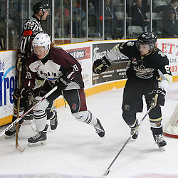 "TRENTON, ON  - MAY 4,  2017: Canadian Junior Hockey League, Central Canadian Jr. ""A"" Championship. The Dudley Hewitt Cup. Game 6 between Trenton Golden Hawks and the Dryden GM Ice Dogs  Woody Galbraith #18 of the Dryden GM Ice Dogs and Mac Lewis #91 of the Trenton Golden Hawks skates after the puck during the second period.<br /> (Photo by Tim Bates / OJHL Images)"