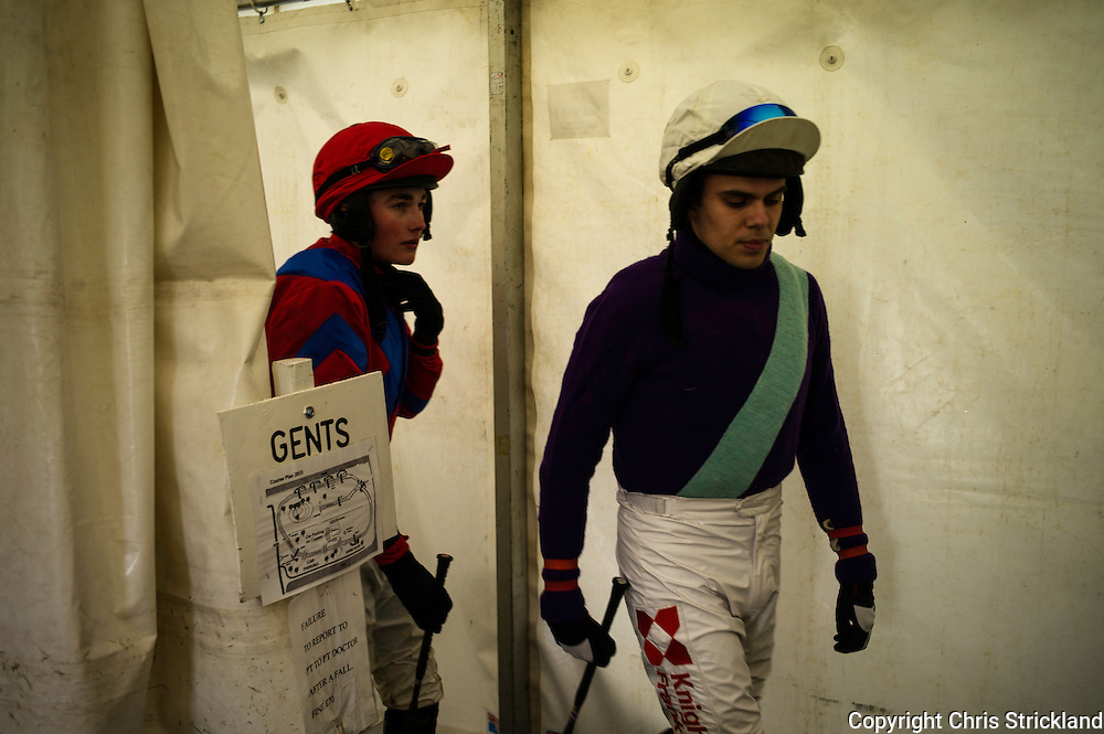 Jockeys T. Speke (right) and C. Bewley exit their changing rooms to ride the Restricted race and compete for the Wells Trophy 2013.