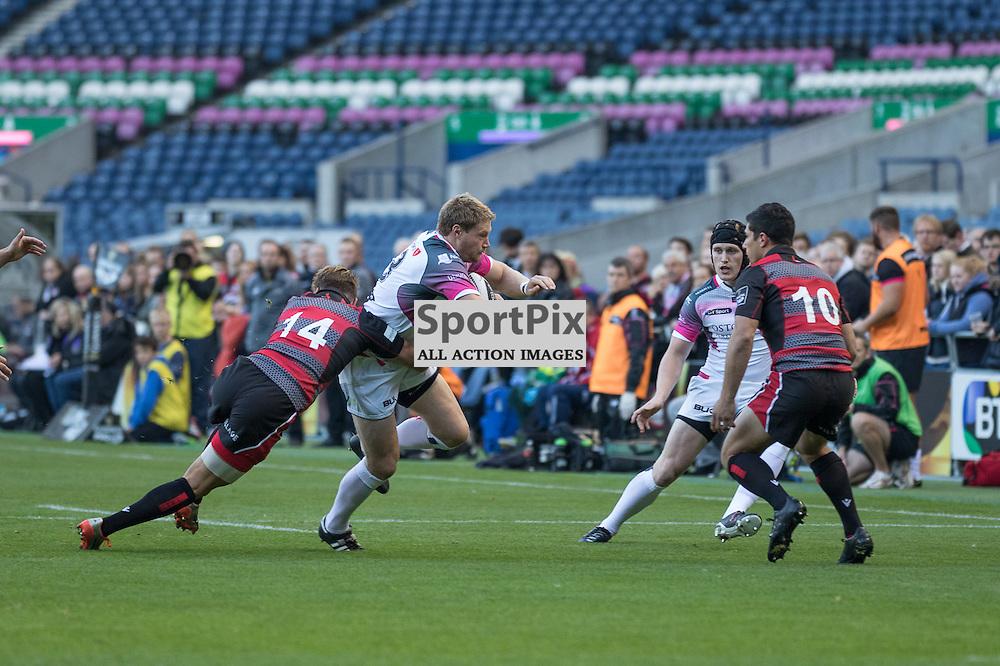 Ospreys #12 Ben John is tackled by Edinburgh Rugby #14 Tom BROWN .  Edinburgh Rugby v Ospreys, 2nd October 2015