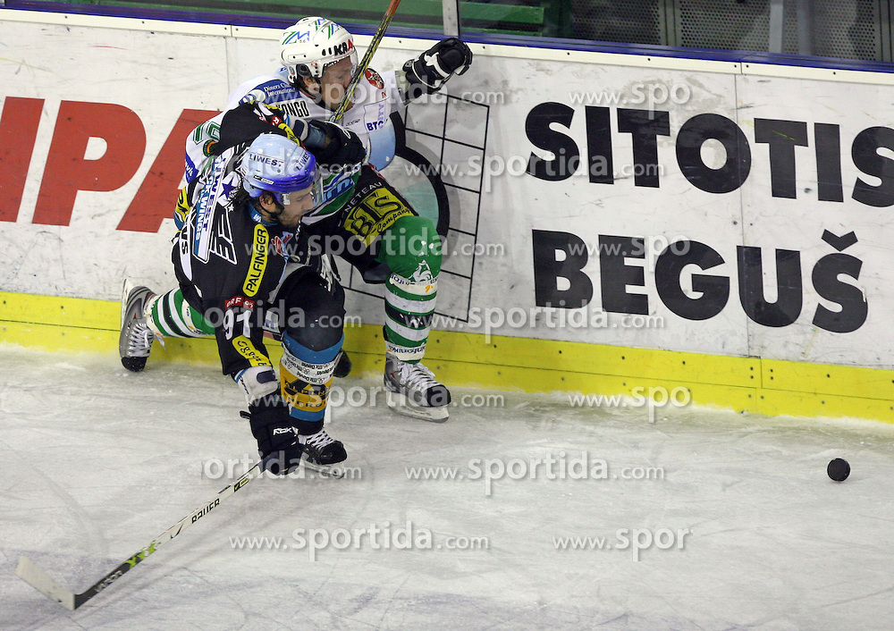 Viktors Ignatjevs of Linz and Egon Muric of ZM Olimpija at ice hockey matchZM Olimpija vs Liwest Linz in second round of semi-final of Ebel League (Erste Bank Eishockey Liga),  on February 28, 2008 in Arena Tivoli, Ljubljana, Slovenia. Win of ZM Olimpija 3:2. (Photo by Vid Ponikvar / Sportal Images)