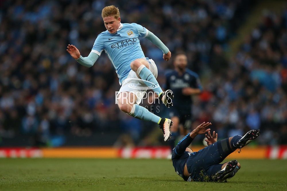 Manchester City midfielder Kevin De Bruyne (17) mis tackled by Real Madrid midfielder Casemiro (14)   during the Champions League match between Manchester City and Real Madrid at the Etihad Stadium, Manchester, England on 26 April 2016. Photo by Simon Davies.