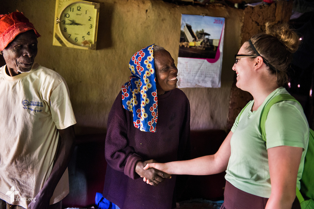 Josephine (center) greets Marley Stein of the Mercy Medical Team at her home Monday, June 9, 2014, in rural Kakmega County, Kenya. Stein is part of the medical team making home visits to surrounding communities. LCMS Communications/Erik M. Lunsford