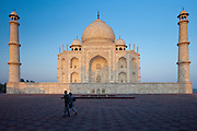 Tourists by Taj Mahal mausoleum eastern view, Agra, Uttar Pradesh, India
