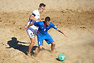 CATANIA, ITALY - AUGUST 16: Corneliu Pavalachi of Moldova competes for the ball with Sander Lepik of Estonia during the Euro Beach Soccer League match between Moldova and Estonia on August 16, 2019 in Catania, Italy. (Photo by Quality Sport Images)