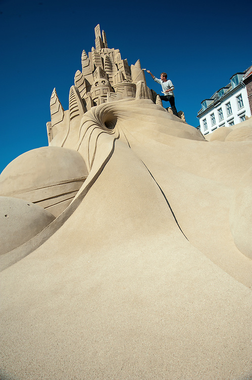 Morton Nauntofte is pictured adding a few finishing touches to one of the sand sculptures at the 2013 Copenhagen Sand Festival